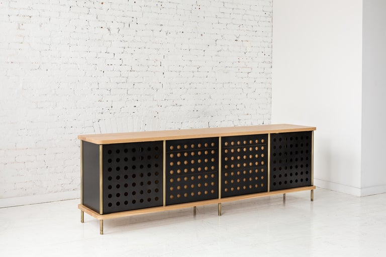 Consistent with the Strata collection, the new Strata credenza is designed to be modular in order to create versatile configurations tailored to your needs. Immediately available as shown with brass rods, white oak top and three powder coated