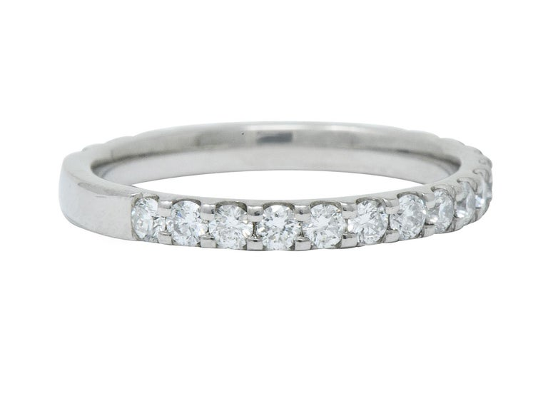 Shared prong style band ring, set to front with round brilliant cut diamonds  Weighing in total approximately .75 carat total with G/H color and SI clarity  With maker's mark  Stamped PT950 for platinum  Circa: 2000s  Ring Size: 5 3/4 & sizable (at