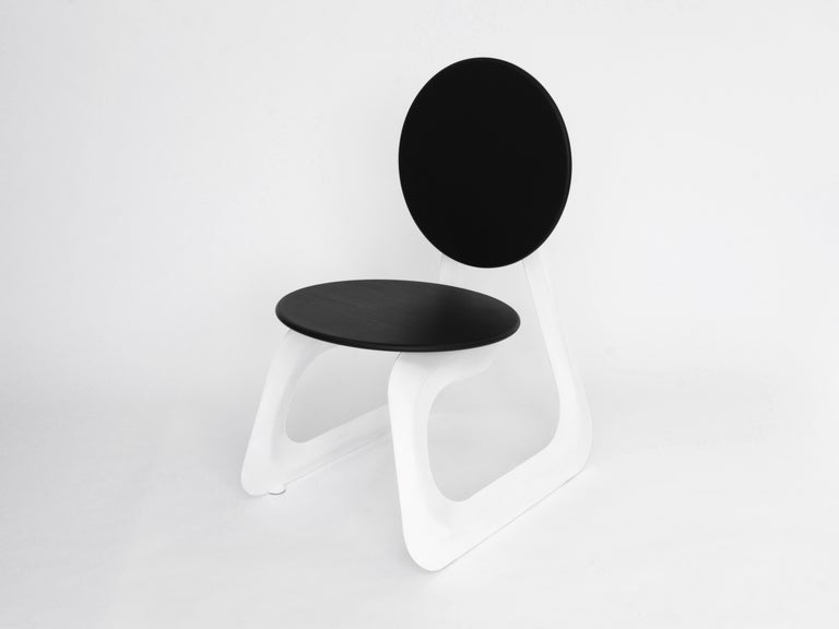 The Aeroformed chair is a futuristic design that showcases the innovative manufacturing process of 'Aeroforming', where air is injected into a sealed envelope of sheet metal, inflating it like a balloon as the internal pressure builds.  Inflating