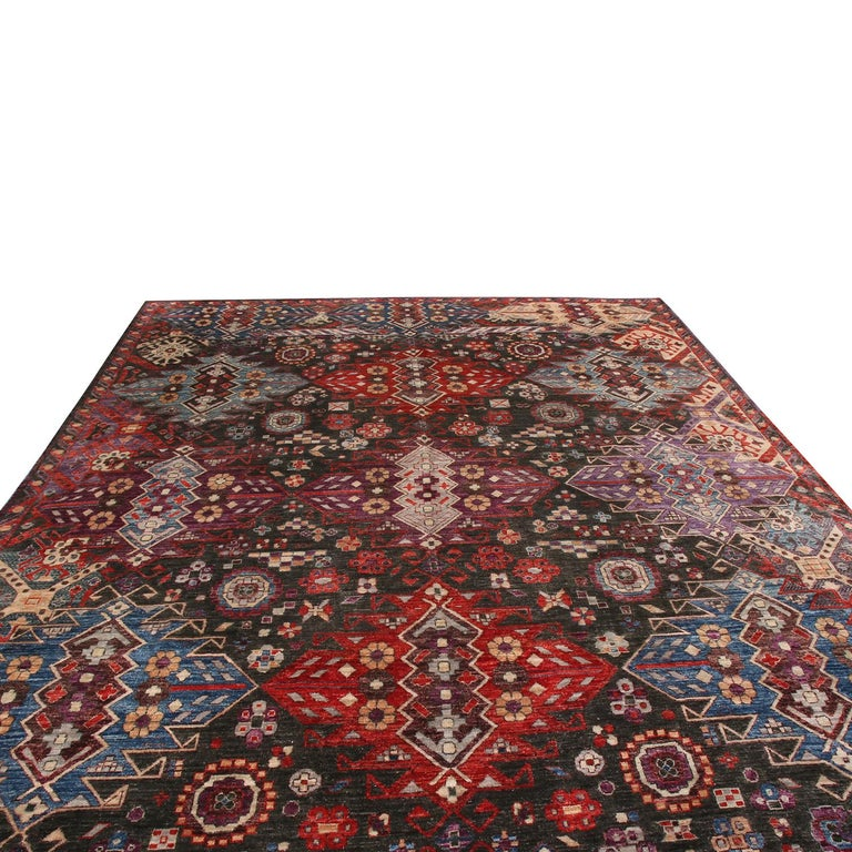 Hand knotted in high-quality wool originating from Afghanistan, this tribal rug hails from Rug & Kilim's premier Burano collection, enjoying an equally intricate geometric field design as it does an array of complementary colorways. Featuring a