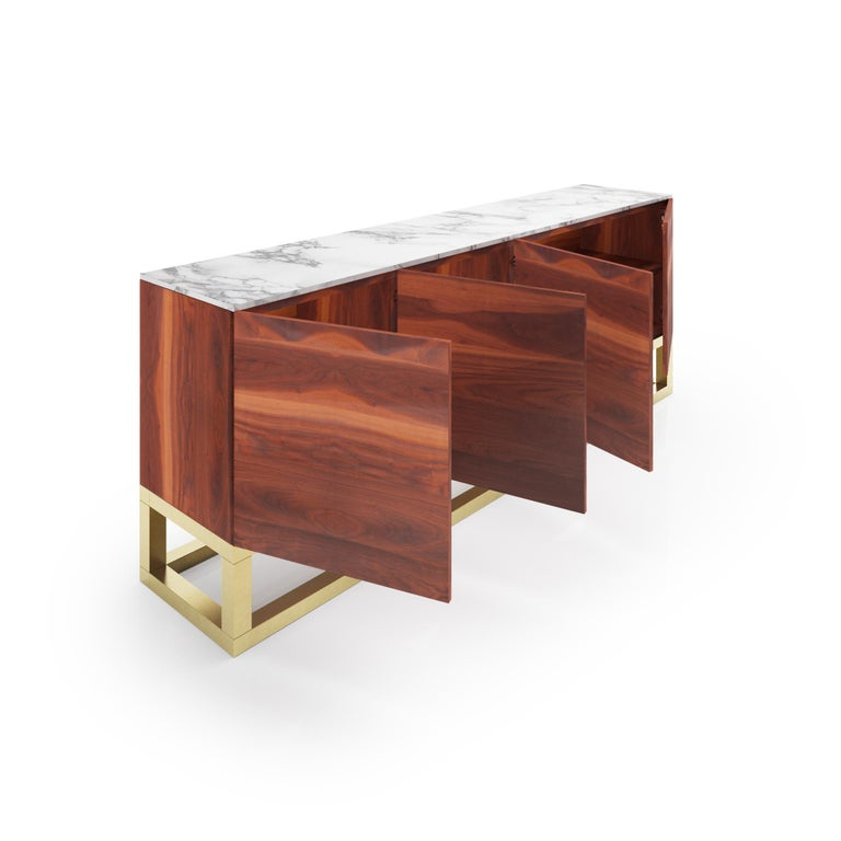 The Akureyri credenza is the perfect combination of elegance and versatility. Its beautiful clean lines and sophisticated low profile don't interfere with its vast capacity for storage. This piece is made of white marble, walnut veneer and solid