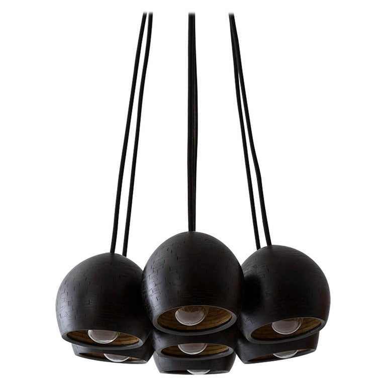 The shape of this clustered seven piece pendant cluster is reminiscent of ostrich eggs. Each shade is hand-built. Stacked piece by piece, 1/4