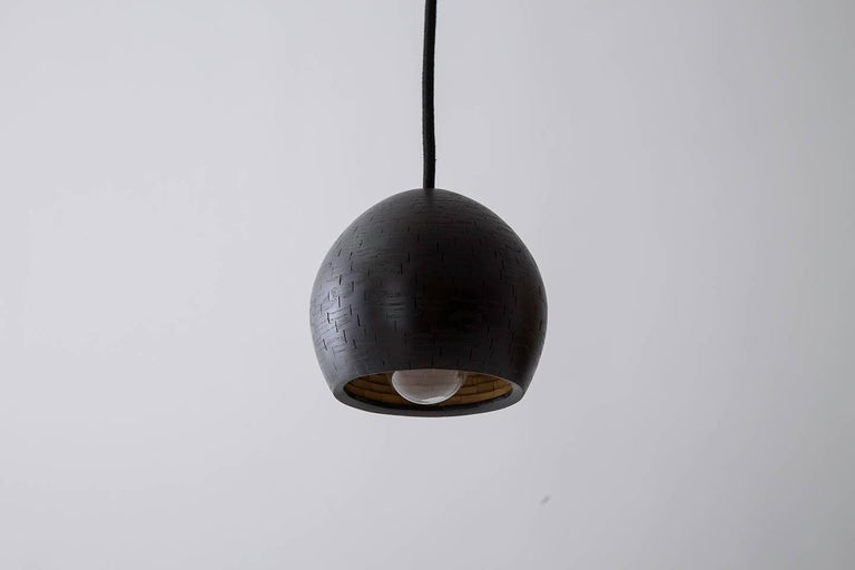 The shape of this single pendant is reminiscent of an ostrich egg. The shades are hand-built. Stacked piece by piece, 1/4