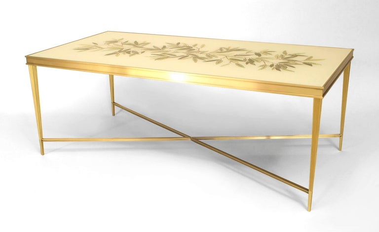 Contemporary Louis XVI-inspired coffee table designed by Carole Gratale. The table features a striated bronze frame with four legs joined by an intersecting stretcher beneath a shimmering rectangular floral églomisé top by Miriam Ellner.   Note: