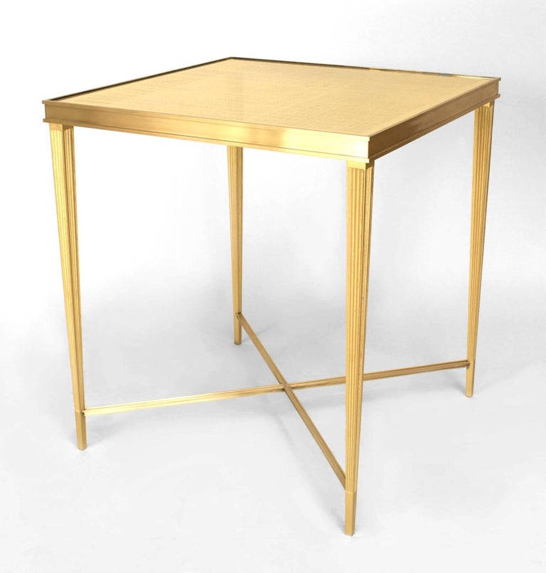 Contemporary Louis XVI-inspired end table designed by Carole Gratale. The table features a striated bronze frame with four legs joined by a low intersecting stretcher beneath a square glittering eglomise glass top by Miriam Ellner.   Note: Custom
