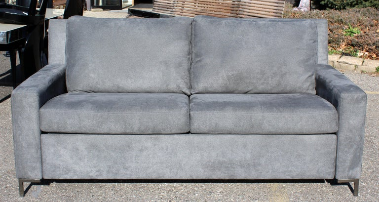 For your consideration is a plush, gray, convertible sleeper sofa by American Leather Co. Sleeper sofa with deluxe mattress. In excellent condition. The dimensions are 74
