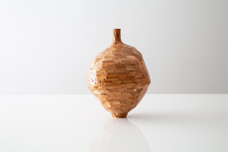 Part of Richard Haining's stacked collection, this vase was made using reclaimed cherry sourced and salvaged from a variety of local Brooklyn wood shops. The wood's natural coloring shows off warm tones ranging dark oranges to light browns and reds,