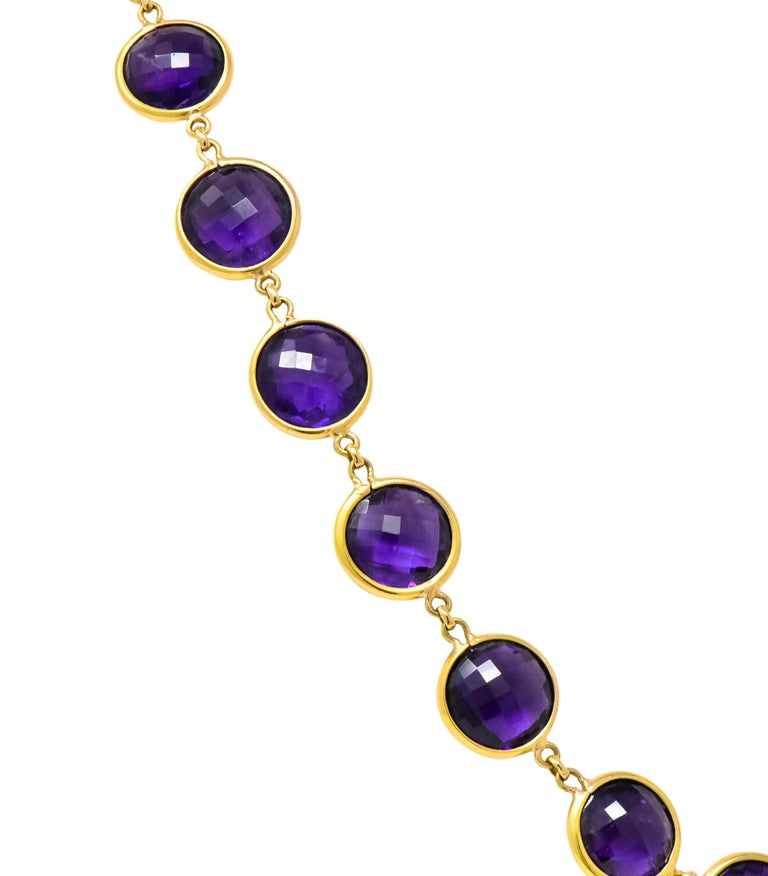 With forty-eight round double cabochon checkerboard cut amethysts   Measuring approximately 12.0 mm  Vibrant royal purple, and very well matched   Each bezel set and completed by a lobster style clasp   Stamped 18K  Length: 37 1/4 Inches  Width: