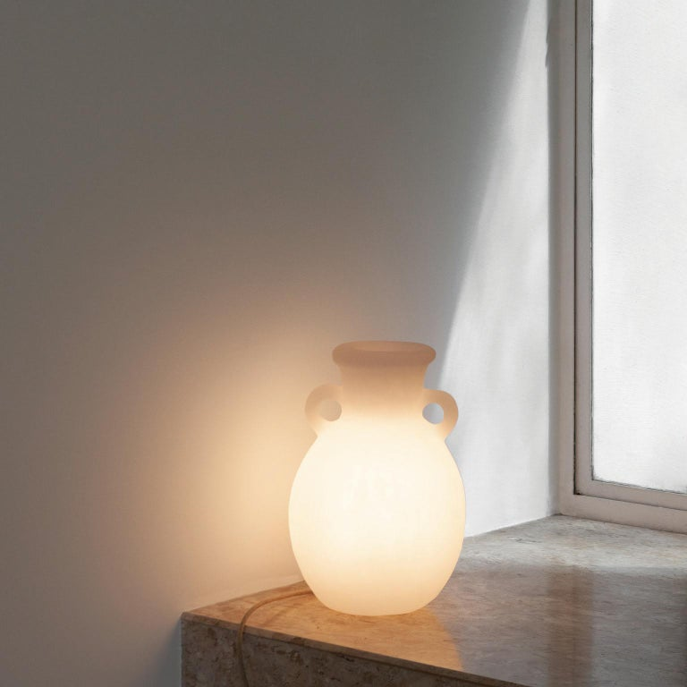 This Contemporary Amphora lamp in Resin was meticulously handmade by master artisans one piece at a time. It is therefore quite difficult, if not impossible to make identical items. The projects are based on a contemporary appropriation of