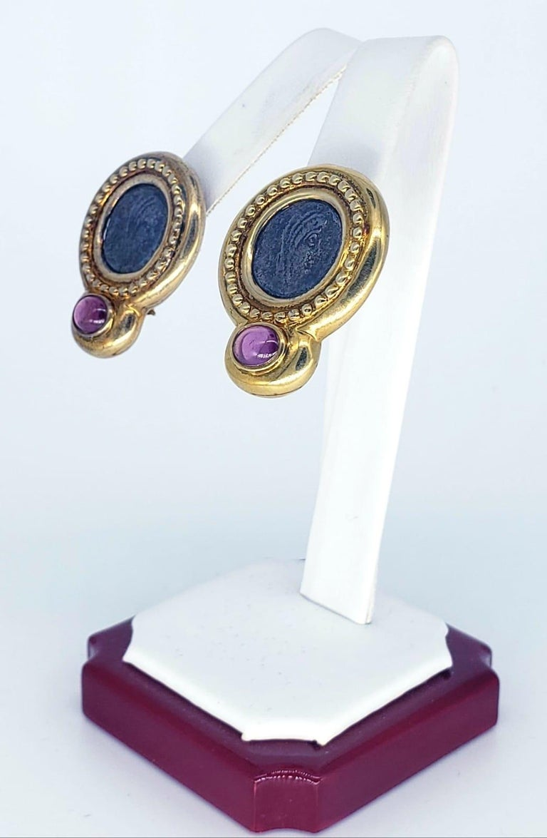 Contemporary Ancient Roman Coin Sapphire Cabochon Earrings. The earrings measure 24.55 X 31.14mm and approx weight 19.5 grams 14k. The earrings are bold and make a strong statement about Ancient Rome and shows signs of wear.