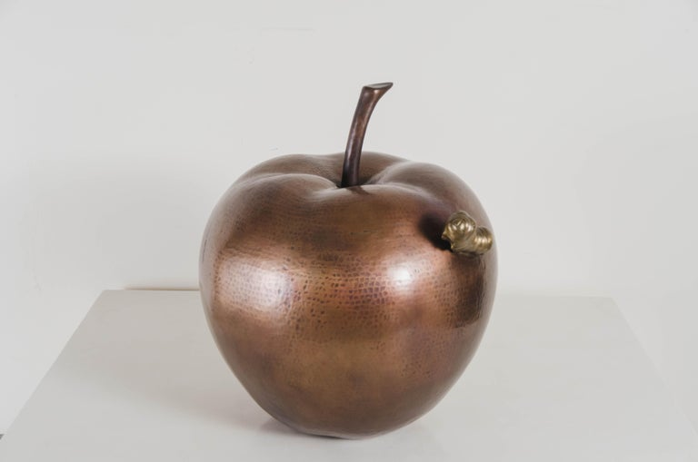 Apple with worm sculpture Antique copper Brass Hand Repoussé Limited Edition Each piece is individually crafted and is unique.   Repoussé is the traditional art of hand-hammering decorative relief onto sheet metal. The technique originated