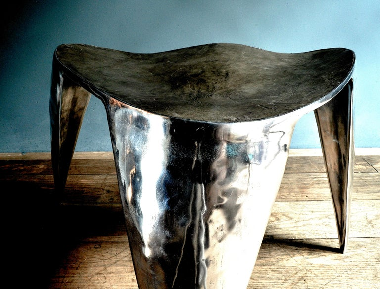 A water flows transformed into furniture, this shiny chair is made of cast aluminium and composed of four parts, subsequently welded and mirror polished to give the surface the special