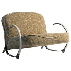 Contemporary Armchair by Hessentia with Decorative Stitching and Metal Structure