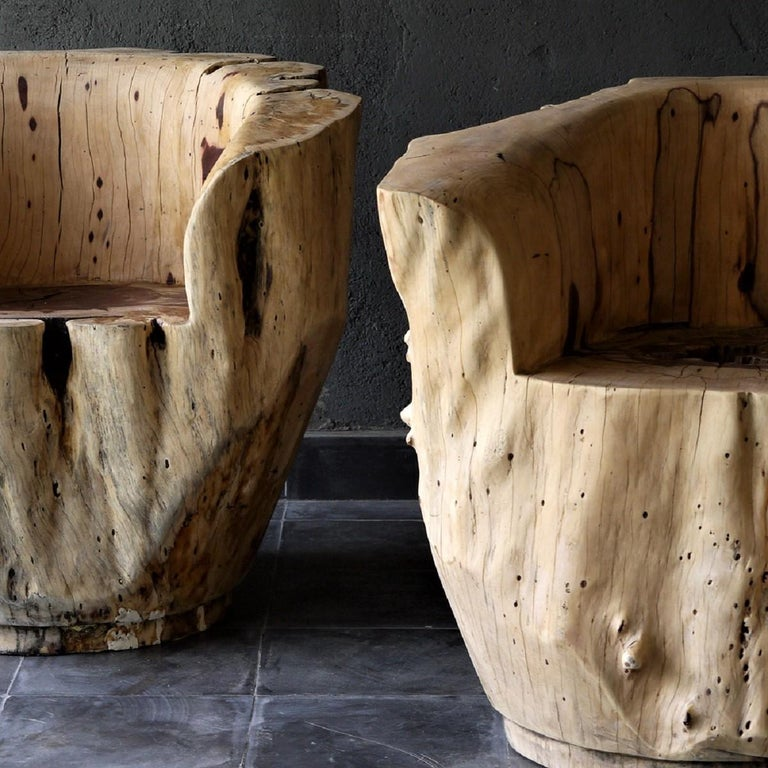Armchair made completely from natural wood and hand-finished without the addition of any treatment. Its a sculptural piece worked from a single block of Tamarind wood. Pieces will slightly vary in shape due to the nature of the unique wood grain.