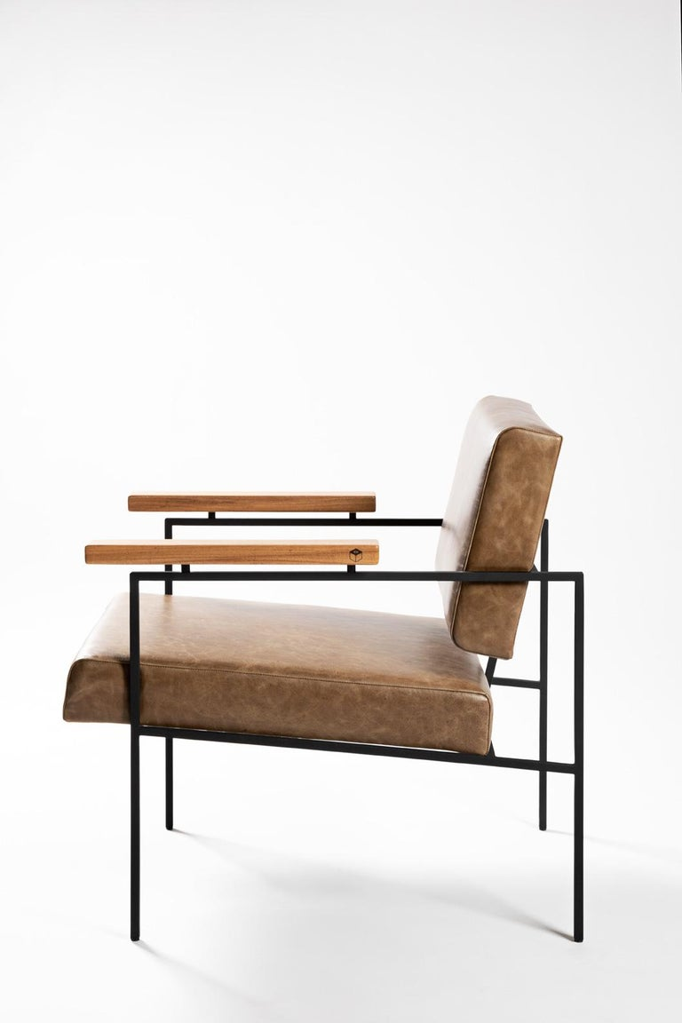 This contemporary styled armchair 'Helena' designed by Samuel Lamas in 2017 has an architectonic and geometric reasoning. The aim is to create a simple chair, with pure geometric shapes. Its square crossbars in solid iron create a perfect meeting