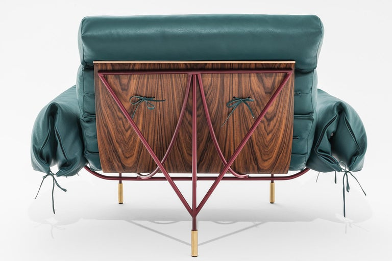 Contemporary armchair Nuvola Paesaggio collection designed by Hannes Peer for SEM. Structure in lacquered iron, brass details. Shell in wood veneered with santos Rosewood, padding in feather, full green leather upholstery. Behind the natural