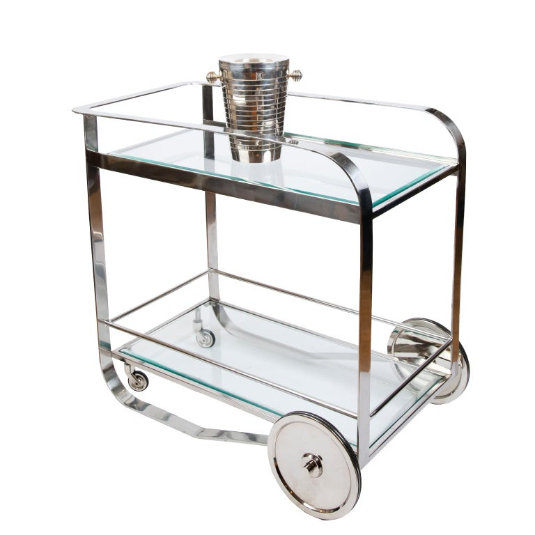 Great design and a great look describe this sleek and stylish metal bar cart beautifully made from polished steel with two tempered glass shelves.
