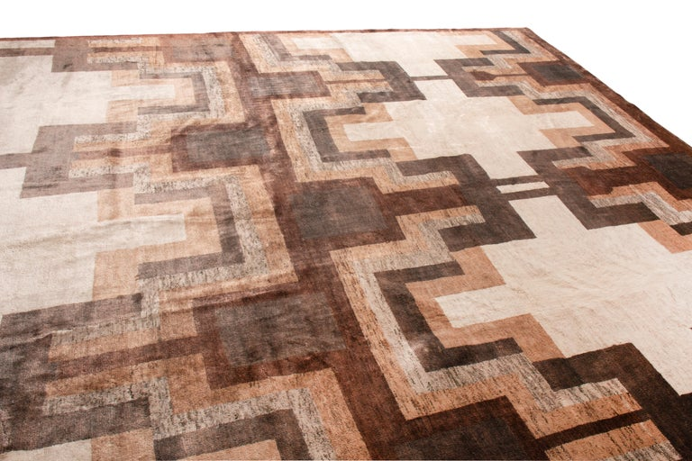 Hand knotted in wool and natural silk, this contemporary addition to Rug & Kilim's new and modern rug collection marries a Classic Art Deco style with a versatile, rich colorway in a soothing repetition. The reserved, humble play of light and dark