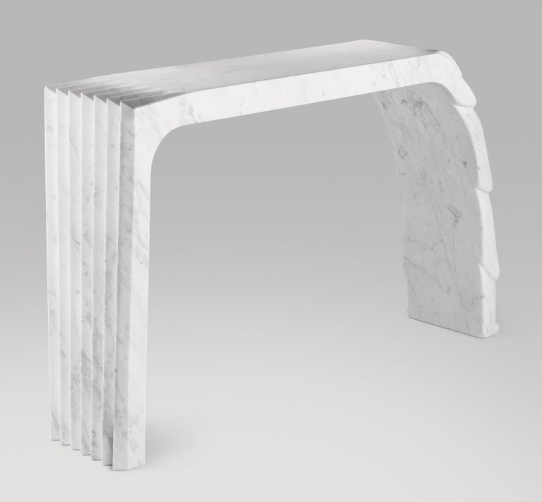 Cosulich Interiors in collaboration with Atelier Terrai: Bespoke console, entirely handcrafted in Italy, out of one solid block in white Carrara marble with an elegant satin finish. The Evolution collection, an organic modern design series, is