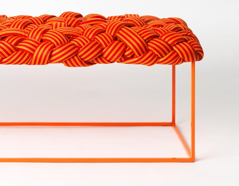 This contemporary bench is part of the Cloud collection was created around the concept of tress. These contemporary styled benches and stools are made with cotton fabric and foam stripes, woven and stitched by hand. Each piece is unique, as the