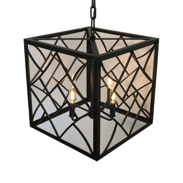Evoking the Art Deco style of the 1920s and 1930s, our Nouveau cube pendant features bold geometric shapes and a chevron motif.   The Black finish and no glass create a contemporary look.  Handcrafted in wrought iron.   3' chain and canopy included