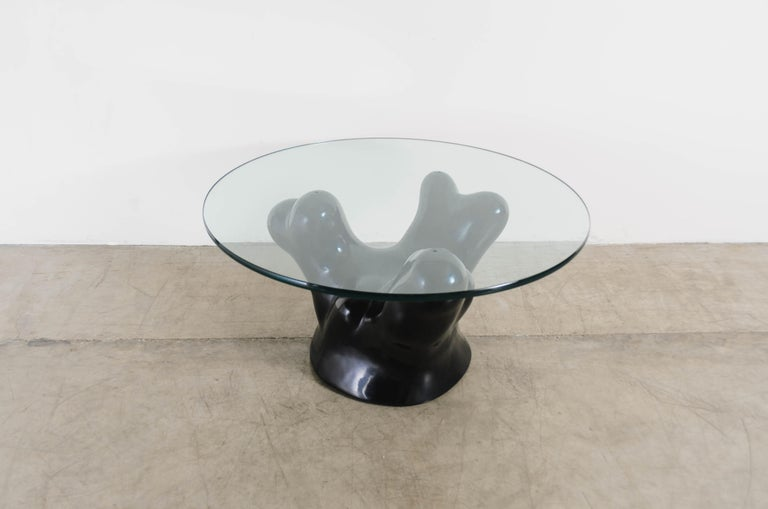 Coral cocktail table w/ glass top Black lacquer Hand repoussé Glass top Limited edition Each piece is individually crafted and is unique.  Lacquer is a technique that dates back to the Shang dynasty, circa 1600-1100 B.C. These pieces are made