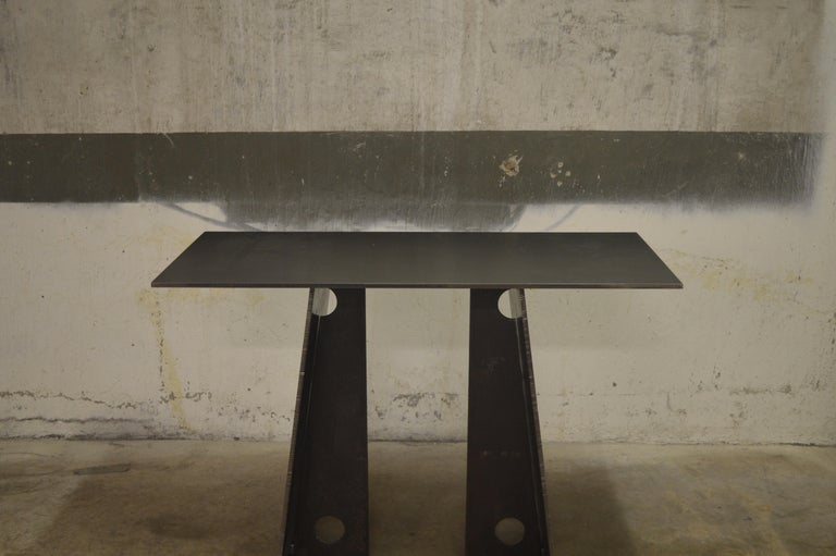 The Bridge Console, an original design, is a contemporary minimalist blackened steel console designed and produced in Vermont by Scott Gordon. Shown here using weathered 3/8