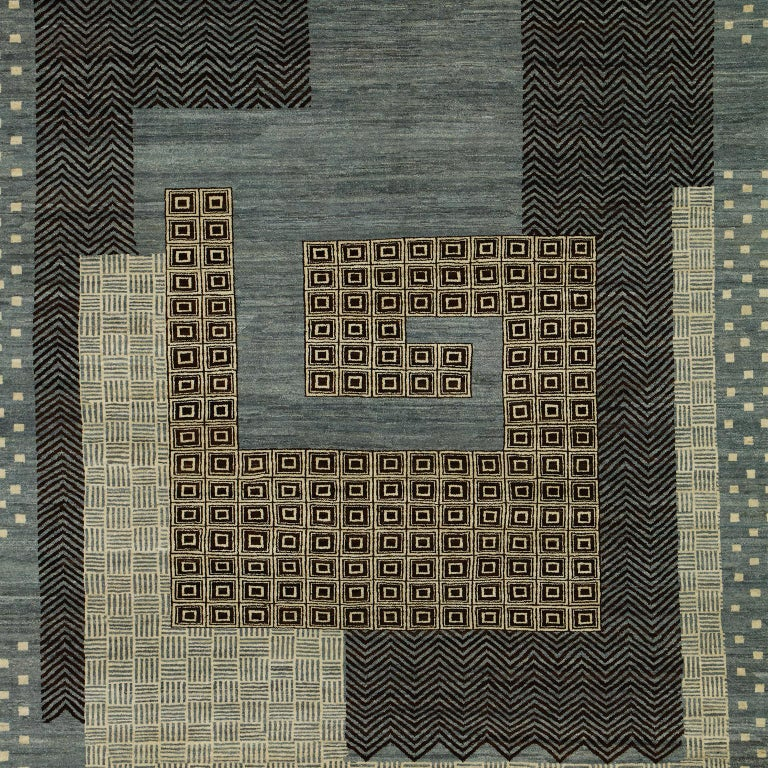 """This blue, cream, gold, and black wool carpet with a modern architectural design, was woven using traditional weaving techniques from all-natural, hand-spun wool. Part of Orley Shabahang's Architectural Collection, this piece titled """"Labyrinth"""""""