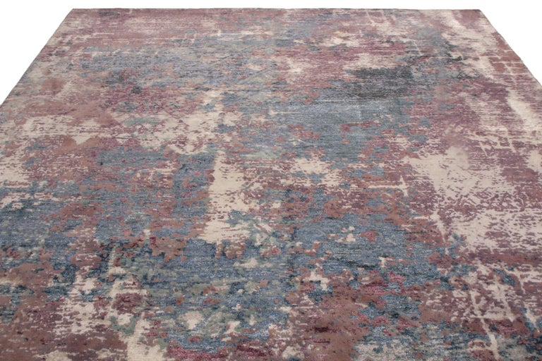Originating from India, this hand knotted wool and silk rug enjoys a distinguished combination of abrash grape purple and metallic blue colorways, given dimensionality by the silk's natural luster and the abstract, borderless field design.