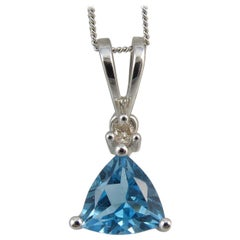 Contemporary Blue Topaz and Diamond Pendant and Chain in White Gold