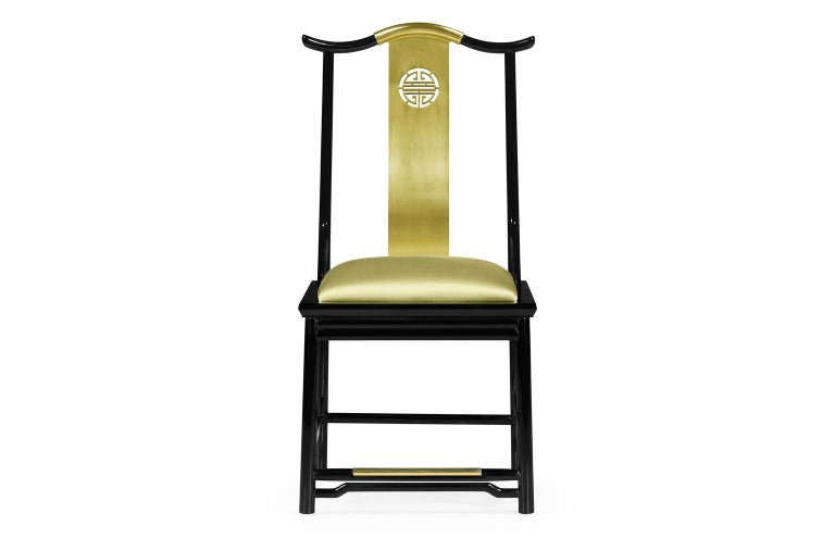 Asian inspired dining chair offered in satin brass and gloss black frame. The seat is upholstered in premium gold silk. Assembled by skilled artisans from stain brass and hand lacquered wood.