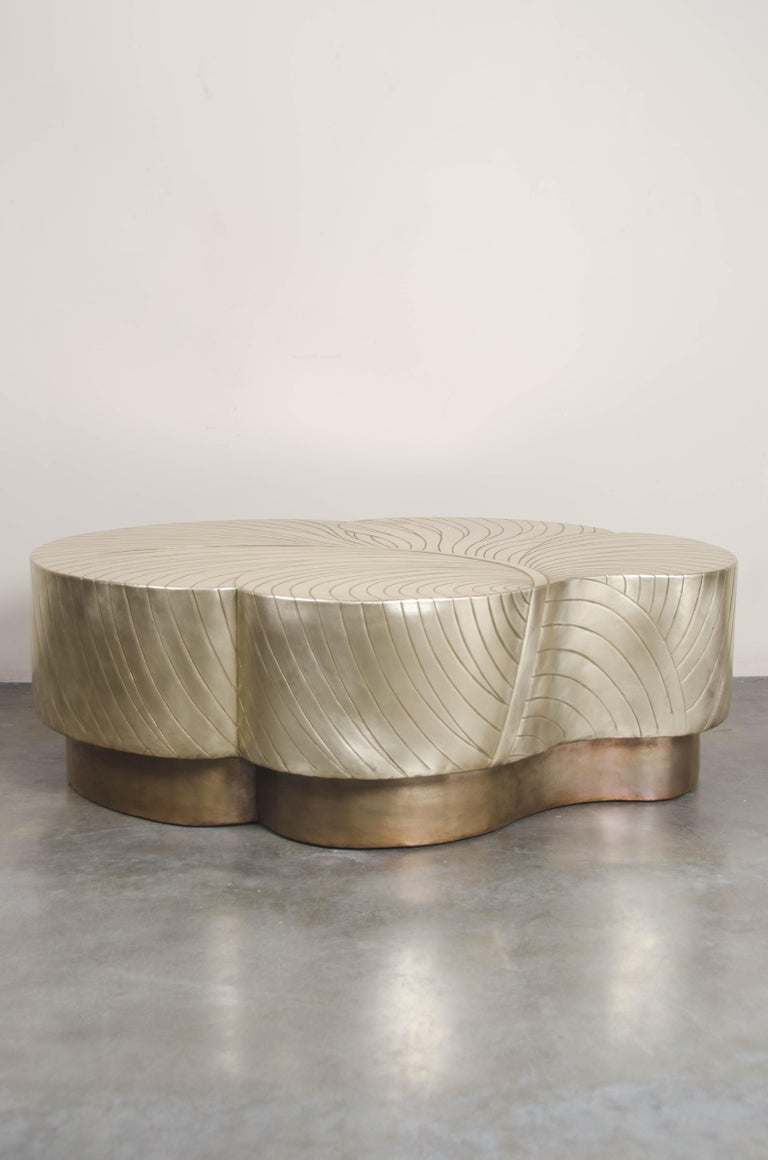 Leaf design cocktail table  Brass Hand Repoussé Limited Edition Each piece is individually crafted and is unique.  Repoussé is the traditional art of hand-hammering decorative relief onto sheet metal. The technique originated around 800 BC