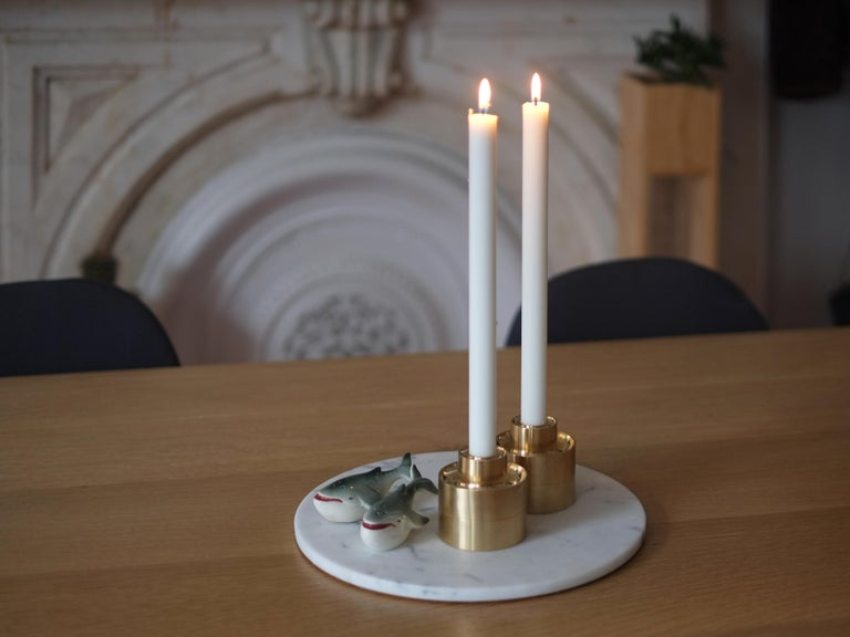 Stack and flip these solid brass candle holders to light up any room.