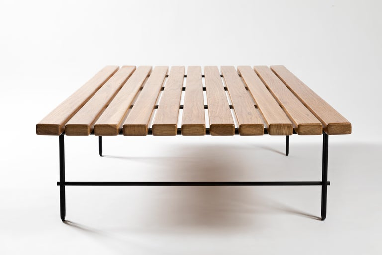 This contemporary styled coffee table in solid steel and wood offers maximum lightness without compromising functionality. With a modern Brazilian DNA, the table is designed in a classic and geometric reasoning. Strength and elegance skilfully