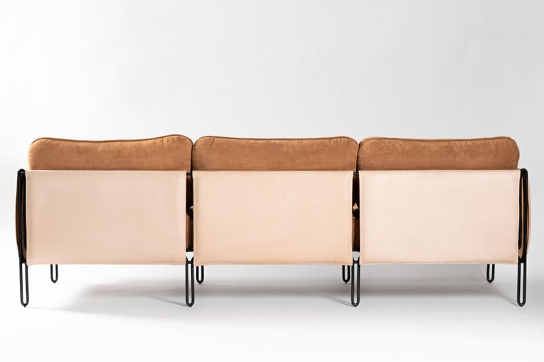 This award winning minimalist  sofa in steel and leather is designed with geometric and architectonic reasoning. Lightness is guaranteed by the delicate iron structure that gently rest the ground. The structure of the sofa is lined with stout