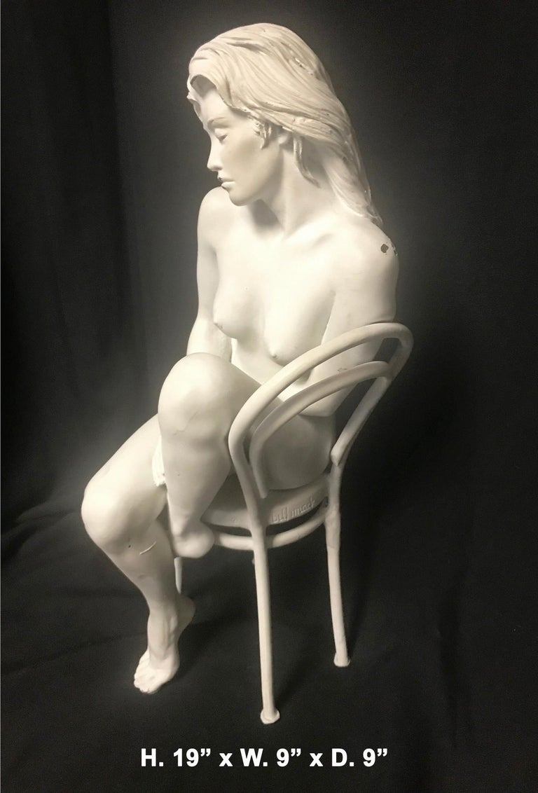 Contemporary bronze depicting a beautiful nude on chair.