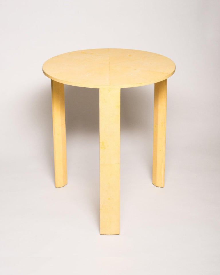 Brighten up your home with this canary yellow authentic Shagreen side table. In a monochromatic world of grey, this table will add that perfect pop of color that you've been looking for. This round table is exquisitely crafted with a veneer wood