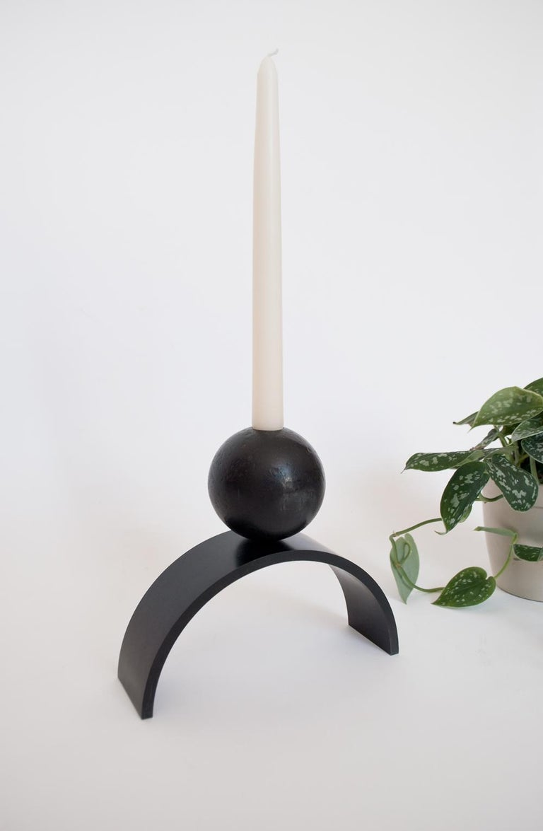 Louis Jobst' arch and ball extra large candle holder. The candle holder is machined from solid steel and patinated black. The candle holder shows off a contemporary form of an arch with a ball / sphere elegantly balancing on top. The design is