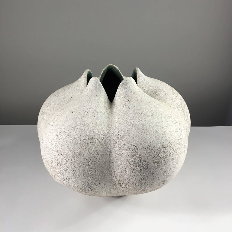 Contemporary ceramic artist Yumiko Kuga's glazed stoneware blossom vase no. 178 is part of her Crackle Series. All of the pieces in this series are hand-built and 100% handmade so they are one-of-a-kind and thus vary slightly from one another. All