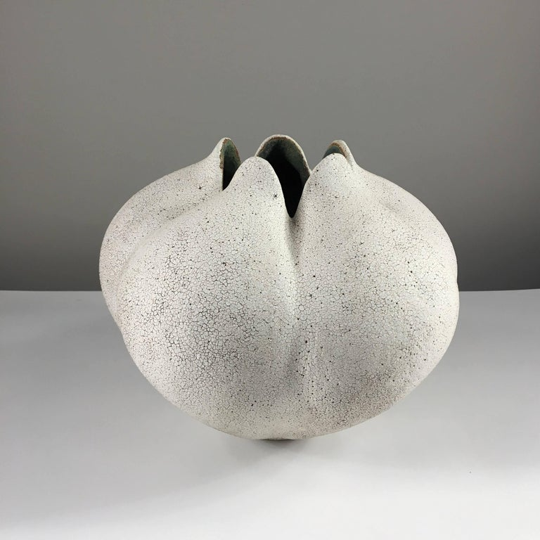 Contemporary ceramic artist Yumiko Kuga's glazed stoneware blossom vase no. 179 is part of her Crackle series. All of the pieces in this series are hand-built and 100% handmade so they are one-of-a-kind and thus vary slightly from one another. All