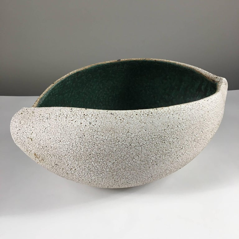 Contemporary ceramic artist Yumiko Kuga's glazed stoneware boat shaped bowl no. 191 is part of her Crackle series. All of the pieces in this series are hand-built and 100% handmade so they are one-of-a-kind and thus vary slightly from one another.