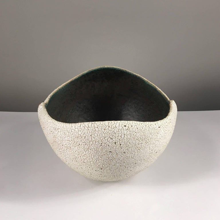 Contemporary ceramic artist Yumiko Kuga's glazed stoneware boat shaped bowl no. 214 is part of her Crackle series. All of the pieces in this series are hand-built and 100% handmade so they are one-of-a-kind and thus vary slightly from one another.
