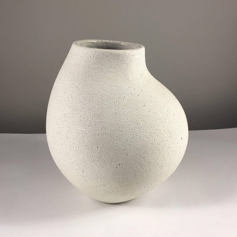 Contemporary ceramic artist Yumiko Kuga's glazed stoneware curved neck vase no. 146 is part of her Crackle series. All of the pieces in this series are hand-built and 100% handmade so they are one-of-a-kind and thus vary slightly from one another.