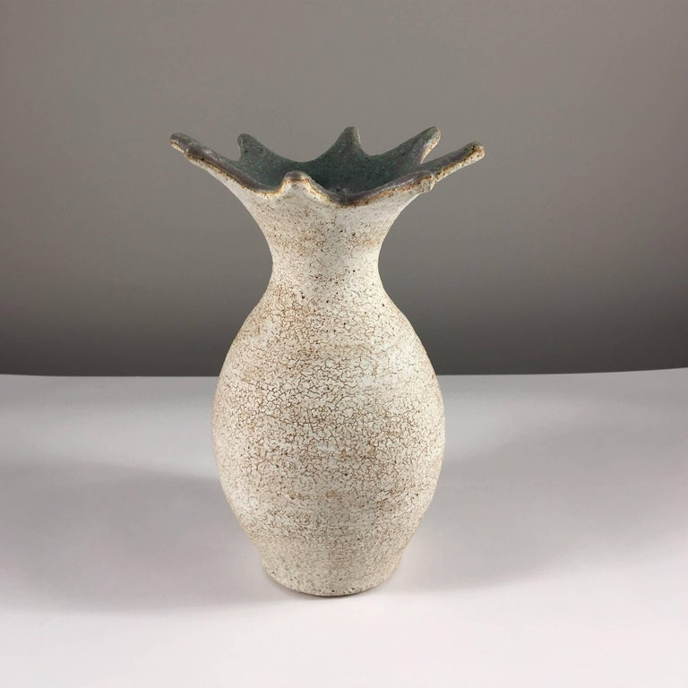 Contemporary ceramic artist Yumiko Kuga's glazed stoneware flared vase no. 215 is part of her Crackle series. All of the pieces in this series are hand-built and 100% handmade so they are one-of-a-kind and thus vary slightly from one another. All