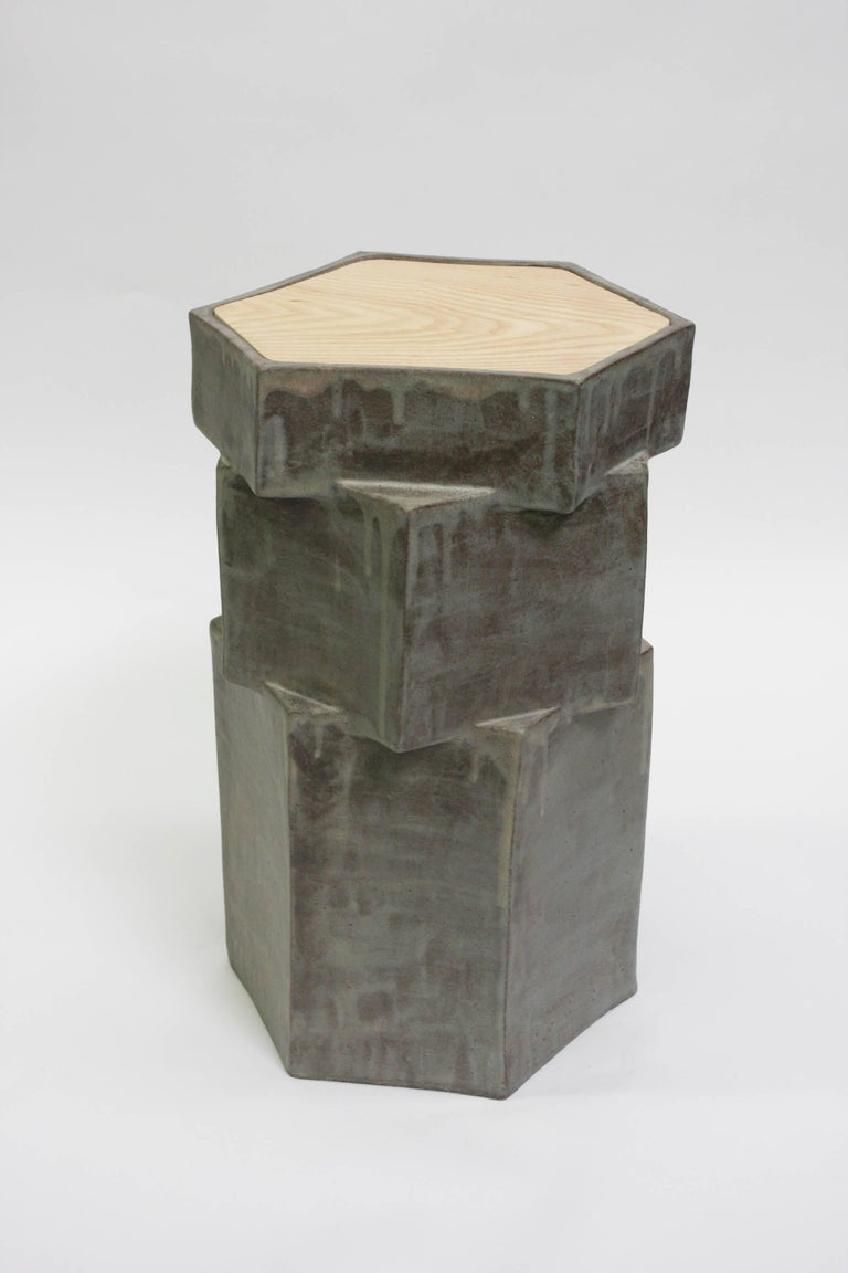 Gray ceramic side table with inset oak top for indoor or outdoor use in warm climates year round. Great indoor next to a sofa, not meant for outdoor use due to Oak top. Unlimited edition, individual side tables are unique in size, glaze, and shape