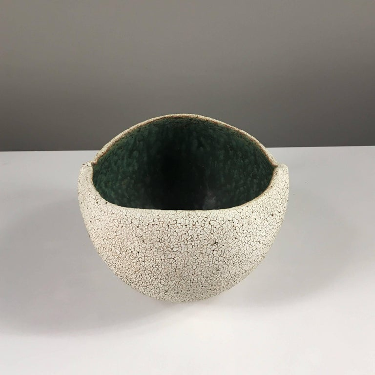 Contemporary ceramic artist Yumiko Kuga's glazed stoneware round bowl no. 170a is part of her Crackle Series. All of the pieces in this series are hand-built and 100% handmade so they are one-of-a-kind and thus vary slightly from one another. All