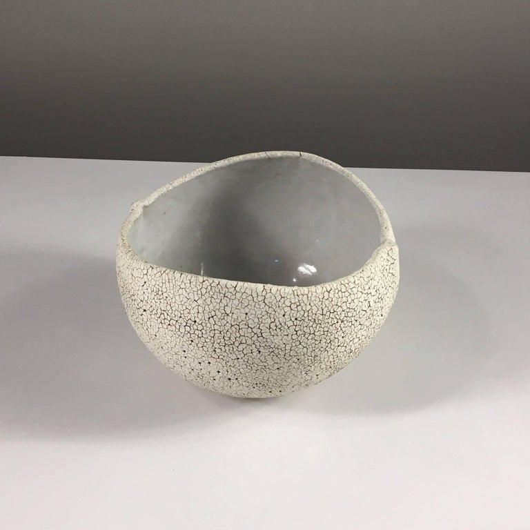 Contemporary ceramic artist Yumiko Kuga's glazed stoneware round bowl no. 171 is part of her Crackle series. All of the pieces in this series are hand-built and 100% handmade so they are one-of-a-kind and thus vary slightly from one another. All