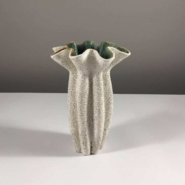 Contemporary ceramic artist Yumiko Kuga's glazed stoneware ruffled neck vase no. 166 is part of her Crackle series. All of the pieces in this series are hand-built and 100% handmade so they are one-of-a-kind and thus vary slightly from one another.