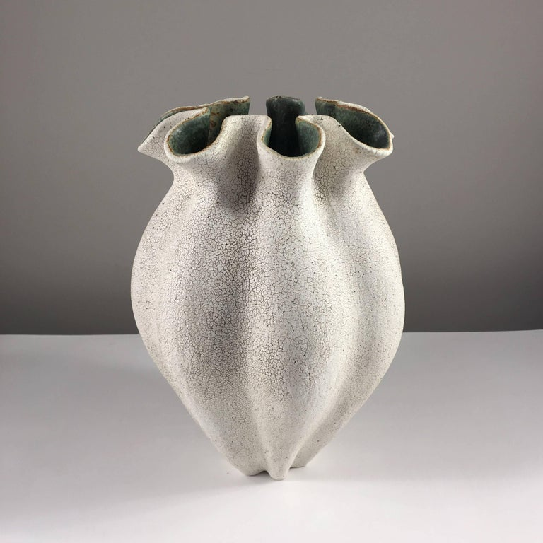 Contemporary ceramic artist Yumiko Kuga's glazed stoneware ruffled neck vase no. 181 is part of her Crackle Series. All of the pieces in this series are hand-built and 100% handmade so they are one-of-a-kind and thus vary slightly from one another.