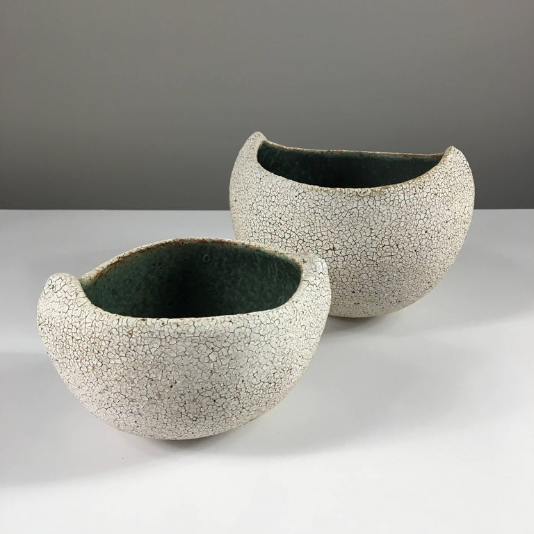 Contemporary ceramic artist Yumiko Kuga's glazed stoneware set of two boat shaped bowls no. 173b are part of her Crackle series. All of the pieces in this series are hand-built and 100% handmade so they are one-of-a-kind and thus vary slightly from